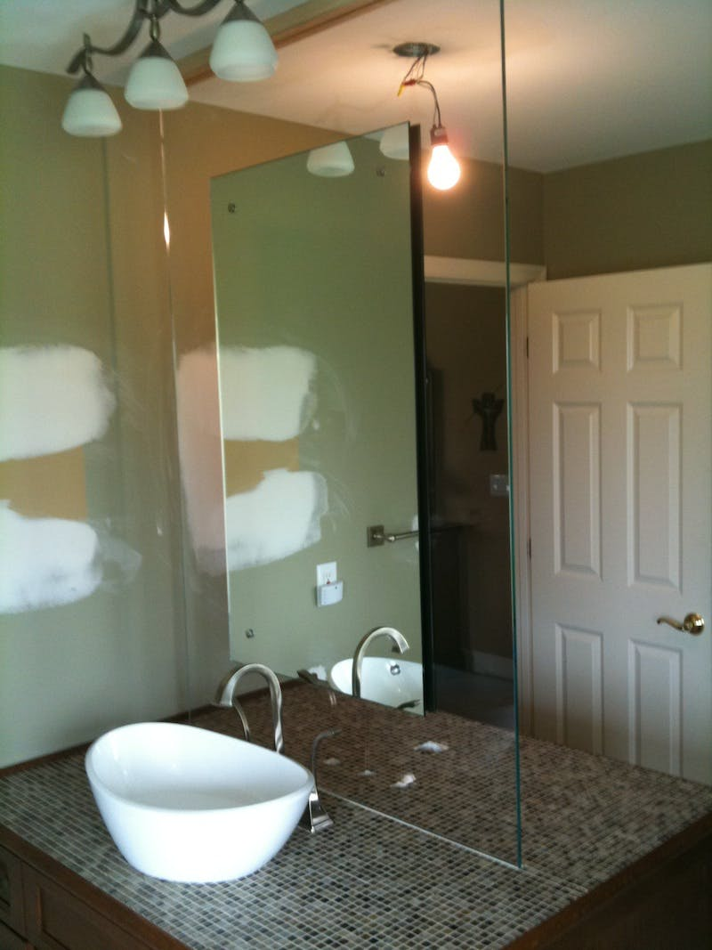 (Bathroom Remodel, Loveland) Mirror Installed to Glass to Appear Floating