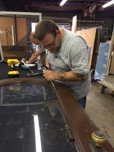Allied Glass & Mirror glaziers restoring an antique door and mirror.