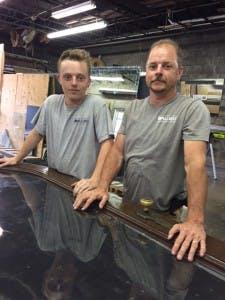 Apprentice Tyler Farmer works alongside his dad, lead glazier Jimmy Farmer.