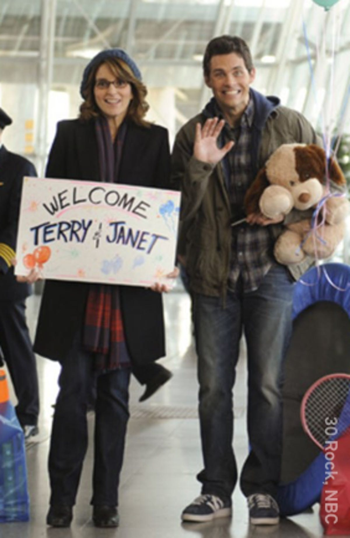 people holding welcome sign