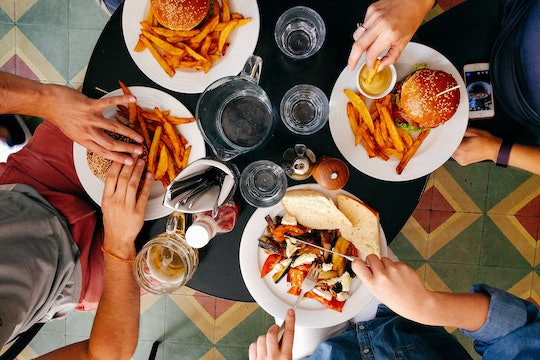 photo of people eating burgers and fries, taken from above