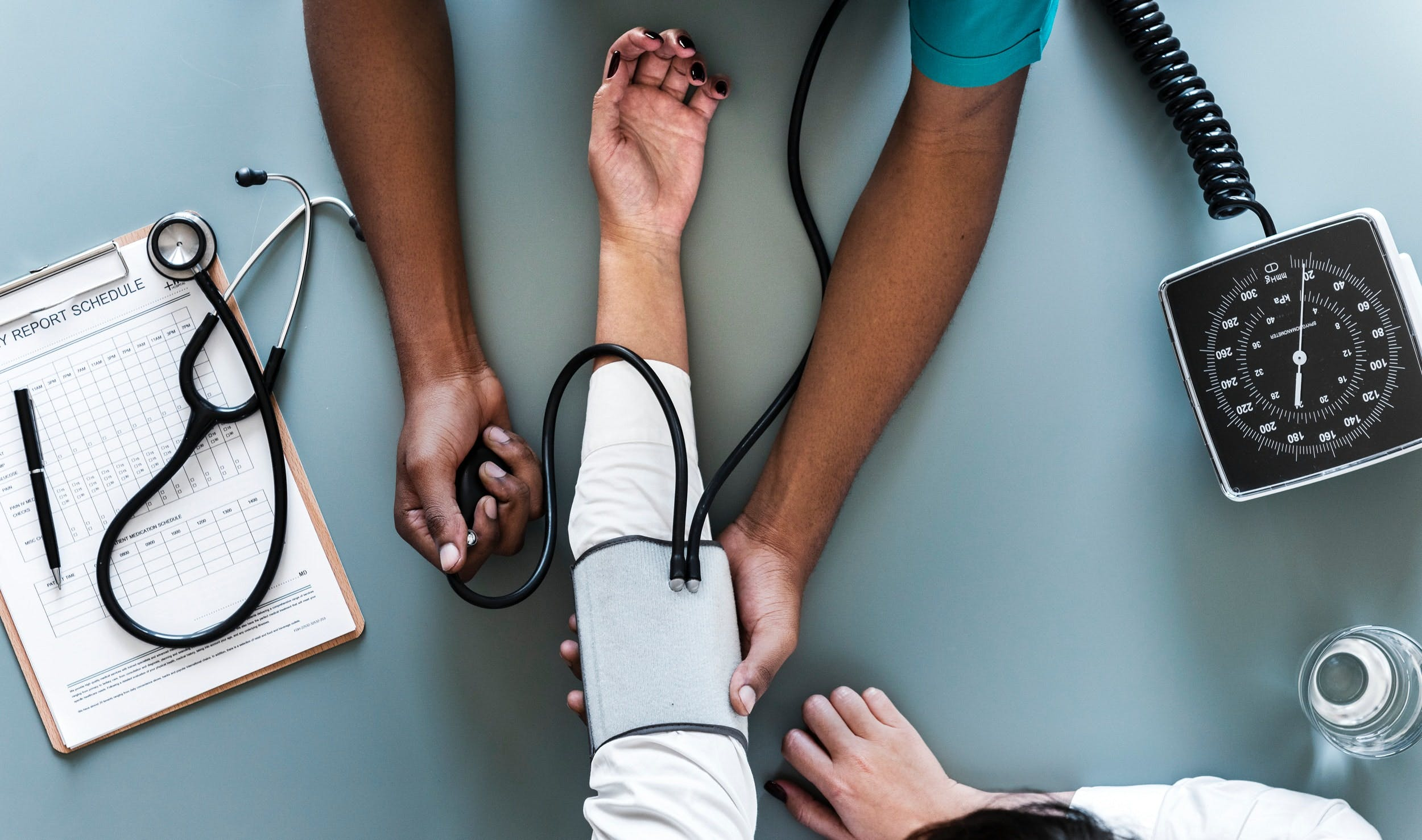 doctors taking blood pressure