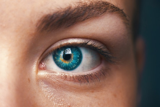 close up of a girl with a blue eye