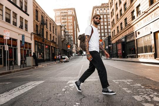a man walking in a city