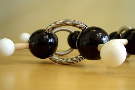 a black and white molecular model made of plastic