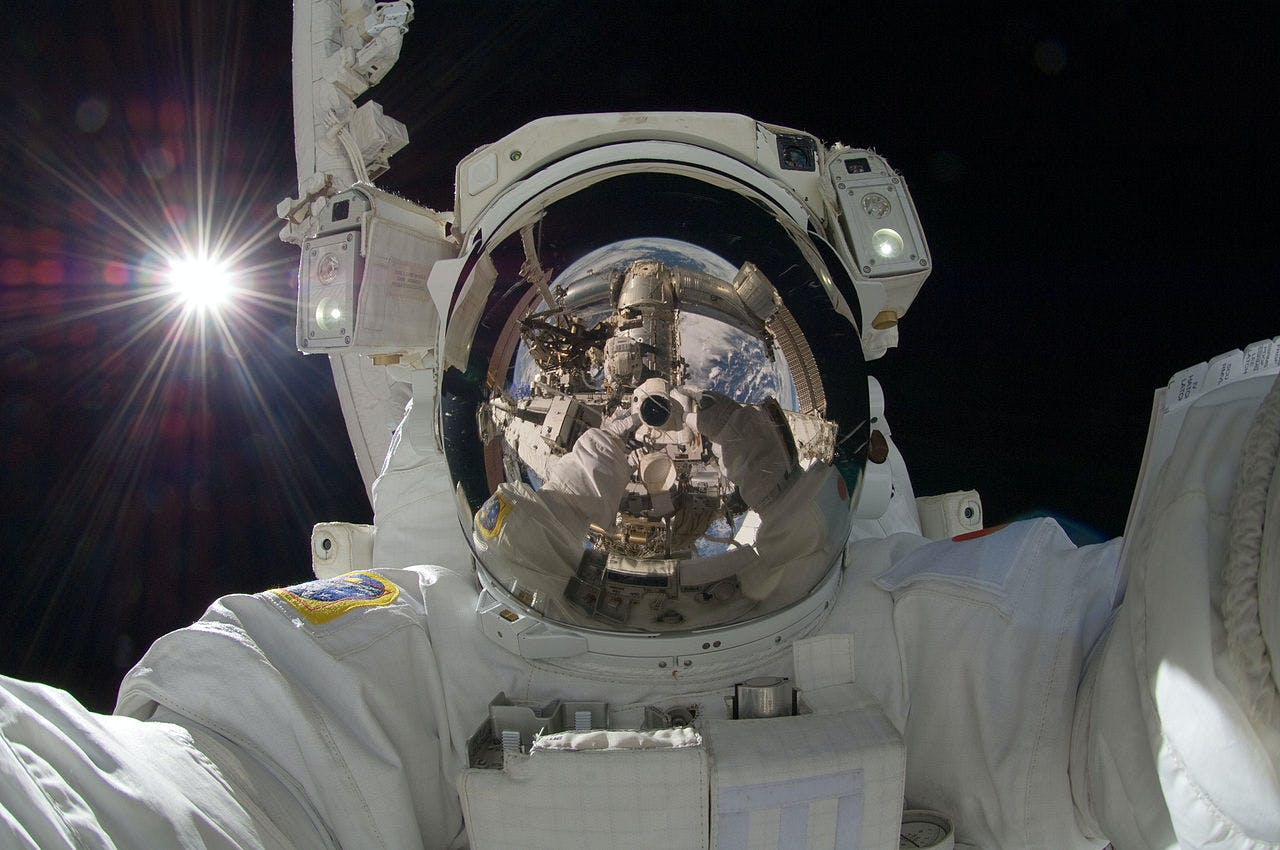 Japan Aerospace Exploration Agency astronaut Aki Hoshide takes a space selfie during an extravehicular activity (EVA).