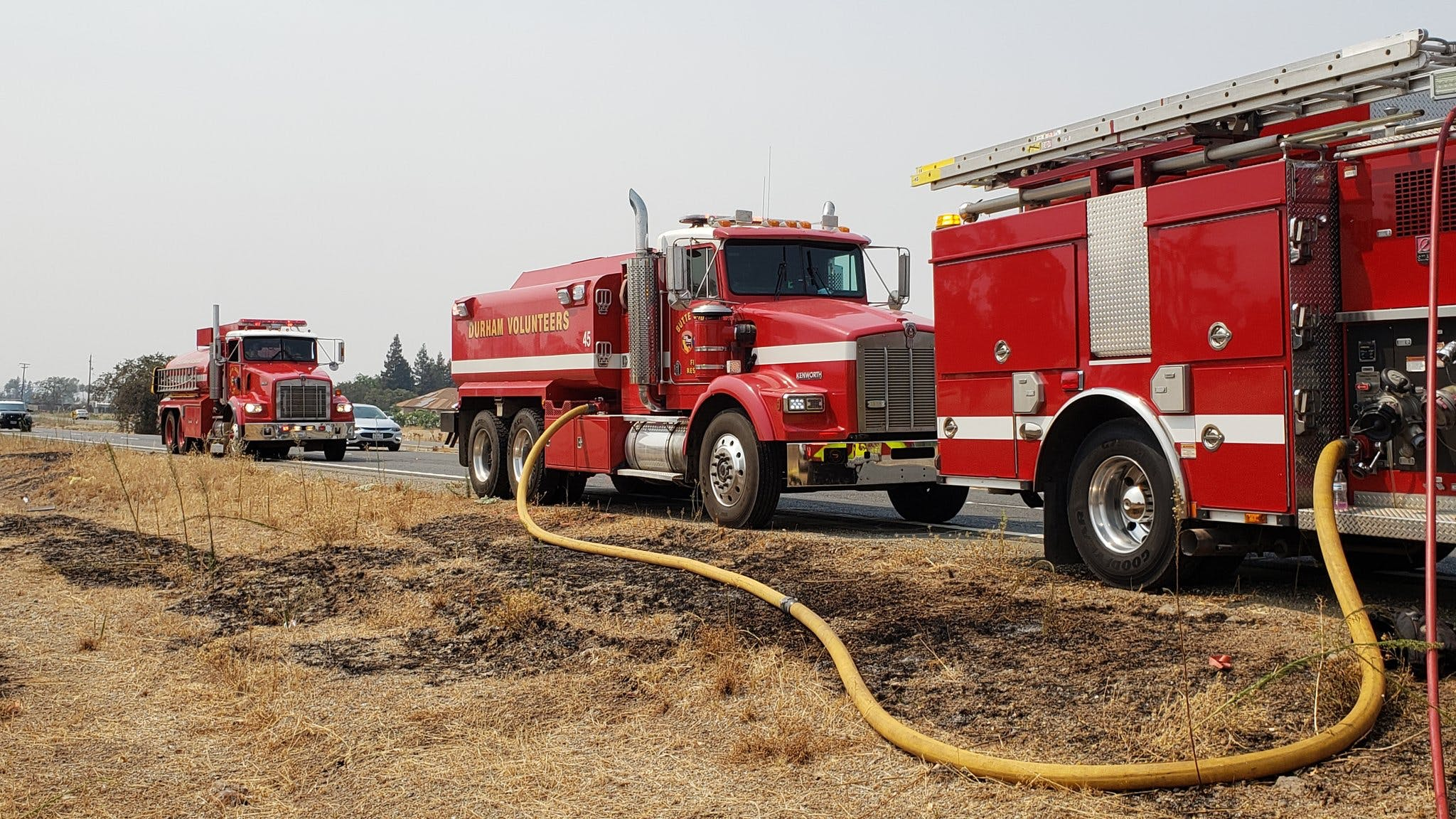Fire trucks near the Skyway Fire in Butte County, California.