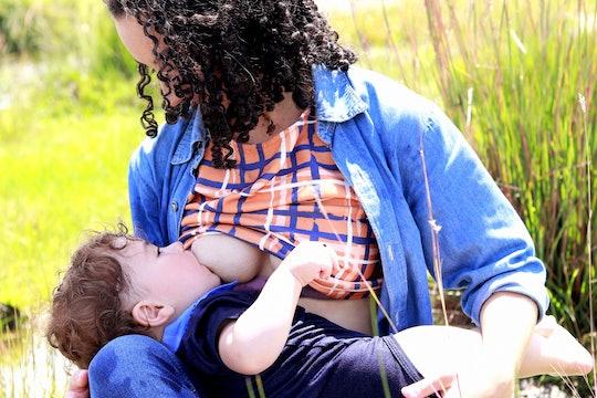 A child breastfeeding/chestfeeding