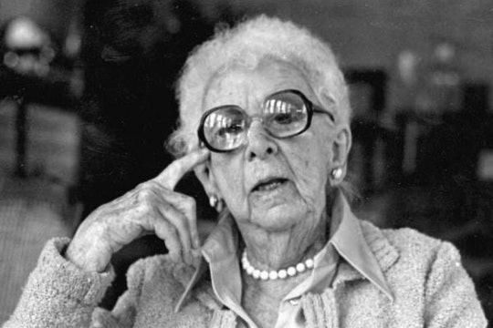 A picture of Marjory Stoneman Douglas, wearing large glasses and a pearl necklace.