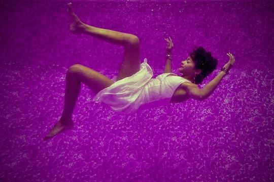 a woman wearing a white dress who looks to be dreaming, against a purple background