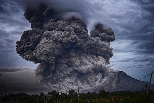 Erupting volcano with huge smoke plume