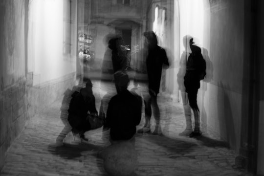 black and white photo of blurry human figures