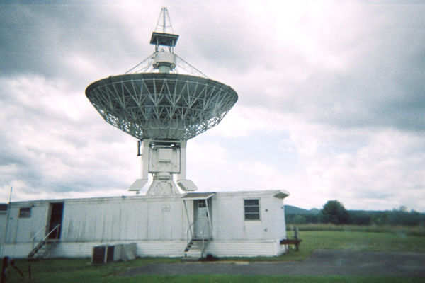 A radio telescope on top of a trailer