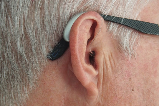 close up of ear of a person wearing a hearing aid