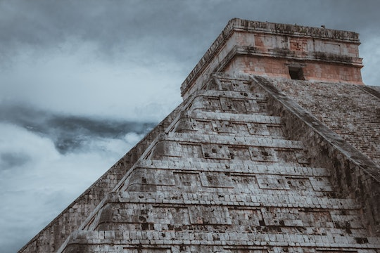 A photo of a stepped Mayan pyramid.