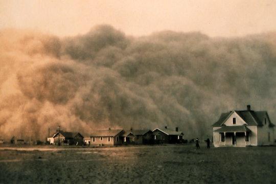 A dust storm approaches a farm in Texas, 1935.