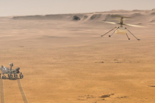 Artist's depiction of the helicopter Ingenuity flying over Mars, with the Perseverance Rover in the background