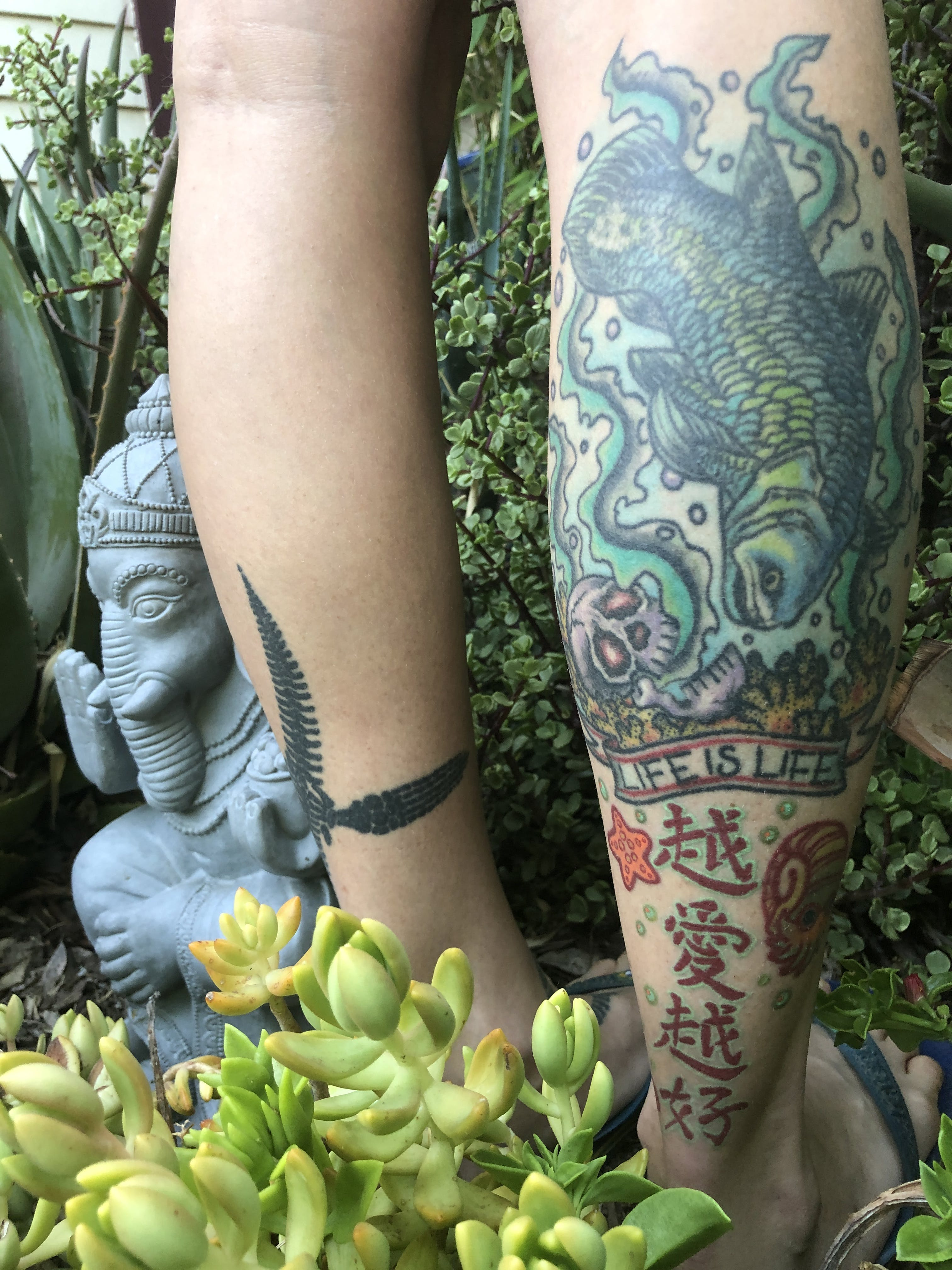 "Some of Jingmai O'Connor's tattoos, including the phrase ""life is life."""