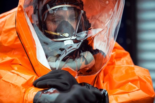person wearing orange hazmat suit