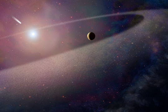 This artist's concept shows a massive, comet-like object falling toward a white dwarf.