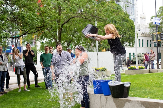 ALS ice bucket challenge water pouring people green grass
