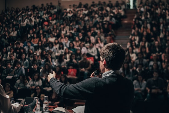 A person giving a speech in front of a conference