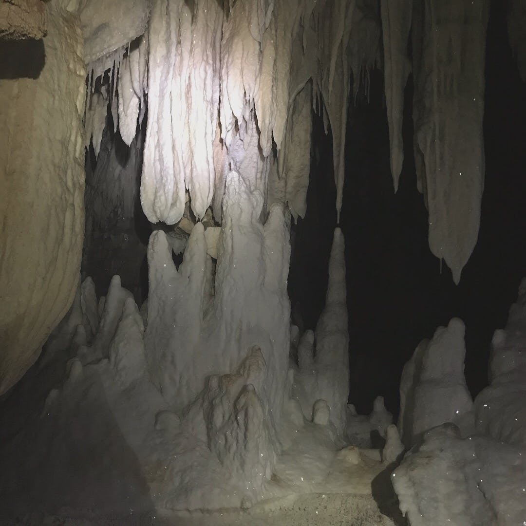 Stalactites and stalagmites in a cave.