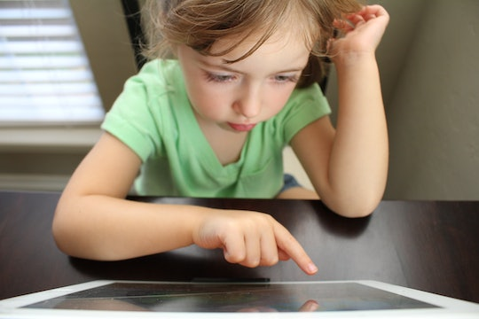 A child uses a touch screen tablet computer.