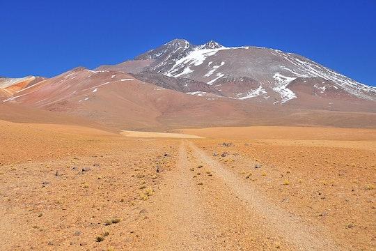 a volcano atop a desert landscape in Chile