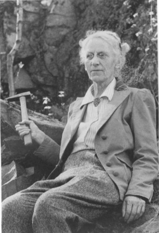 Alice Wilson posing, holding a small pickaxe.