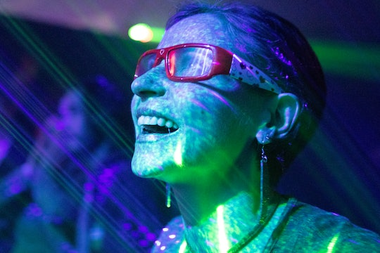 a person wearing glasses with lots of colored lights shining on them