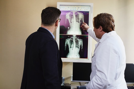 A doctor explains X-ray results to a patient.