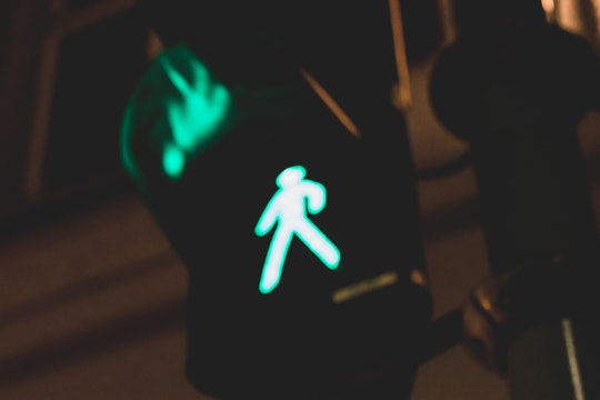 illuminated green pedestrian walk light at night