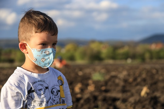a child wearing a face mask