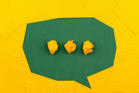 green speech bubble with yellow dots