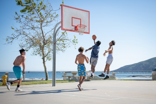 four people playing pick-up basketball