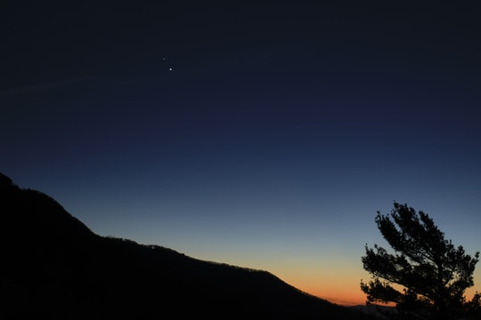 Saturn, top, and Jupiter, below, are seen after sunset from Shenandoah National Park, Sunday, Dec. 13, 2020, in Luray, Virginia.