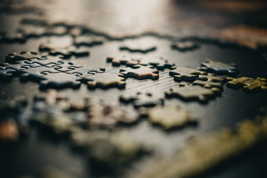 A close-up photo of mixed jigsaw puzzle pieces.