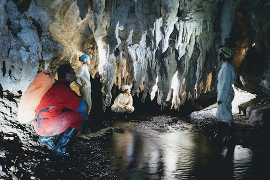 people in a cave