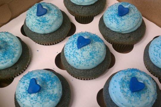blue cupcakes with blue frosting and heart decoration