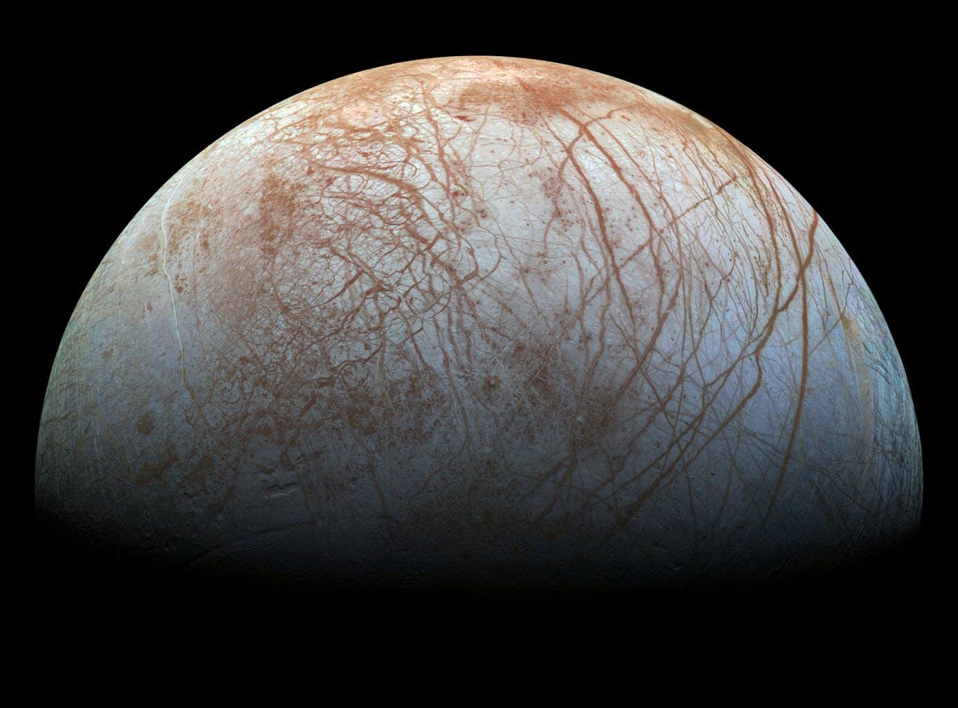 Jupiter's moon, Europa, against black space