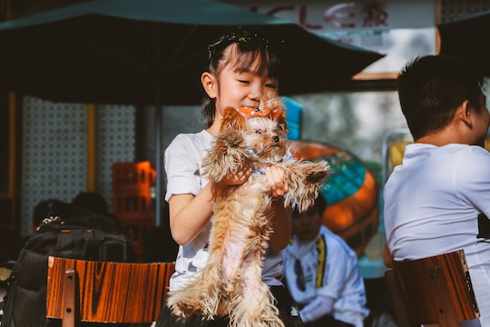 Young girl with her dog