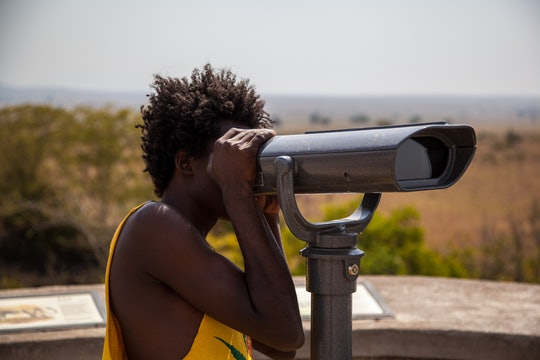 a woman looking through a telescope