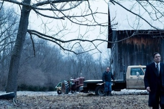 A still from the movie Dark Waters. A man walks in a field against an Appalachian backdrop.