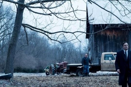 A still from the movie Dark Waters. A man walks in a field against an Appalachian backdrop.