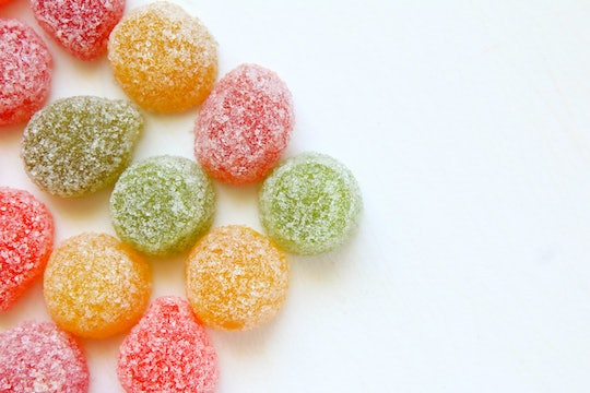red, green, and yellow circular candies covered with sugar