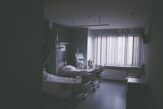 a hospital room in gray tones