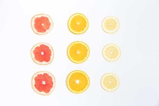 nine slices of citrus fruits arranged in rows against a white background