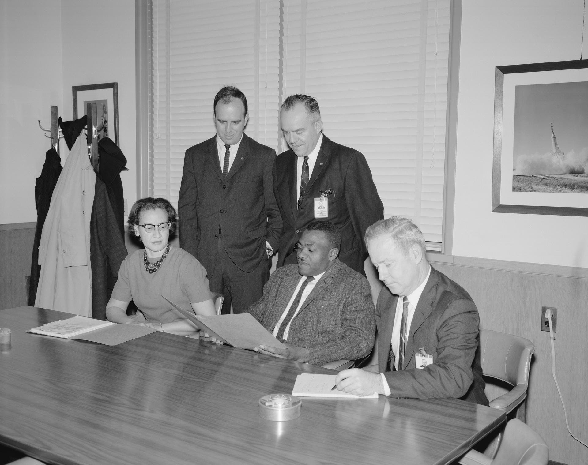 Seated from From Left: Katherine G Johnson, Lawrence W Brown, and J Norwood Evans, Employment Officer. Standing from Left: John J Cox, secretary; and Edward T Maher