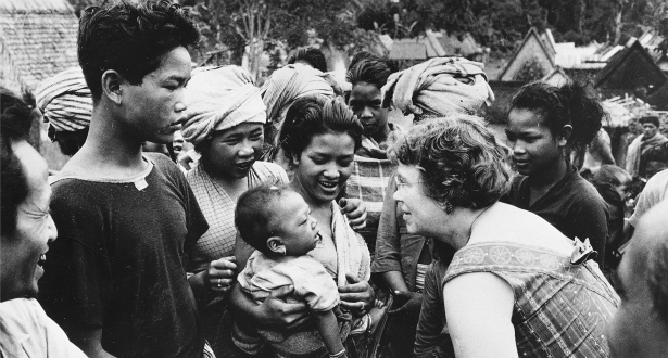 black and white photo of margaret mead talking with samoan people